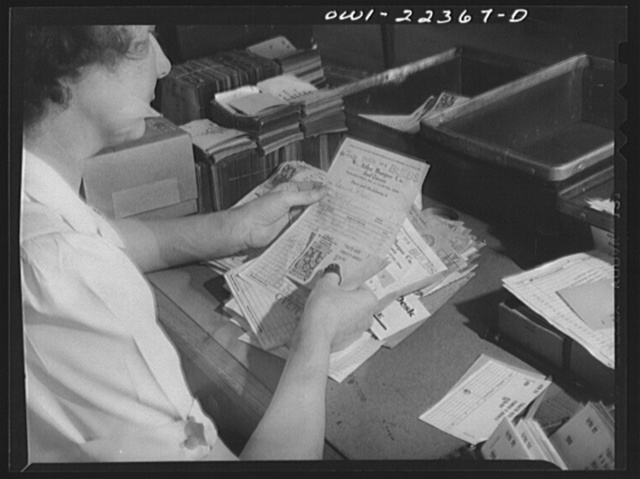 Philadelphia, Pennsylvania. Punching code information on mailing stencils at the W. Atlee Burpee Company, seed dealers
