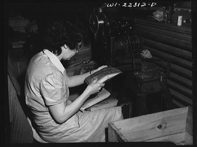 Philadelphia, Pennsylvania. Stapling paper bags containing bulbs at the W. Atlee Burpee Company, seed dealers