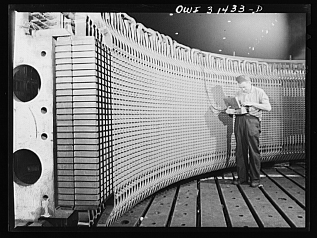 Philadelphia, Pennsylvania. Stator frame of the 30,000 kilowatt generator which Westinghouse Electric Company is manufacturing for the Watts Bar Dam of Tennesse Valley Authority (TVA). It is lined with thousands of armature coils, and over 100,000 sheets of laminated iron which serve to conduct the electricity. The stator frame is part of the generator inside of which revolves the rotor or revolving part. The whole frame weighs 425,000 pounds and is shipped in four quarter sections. A worker measures the resistance of the windings. The frame measures 378 inches in diameter