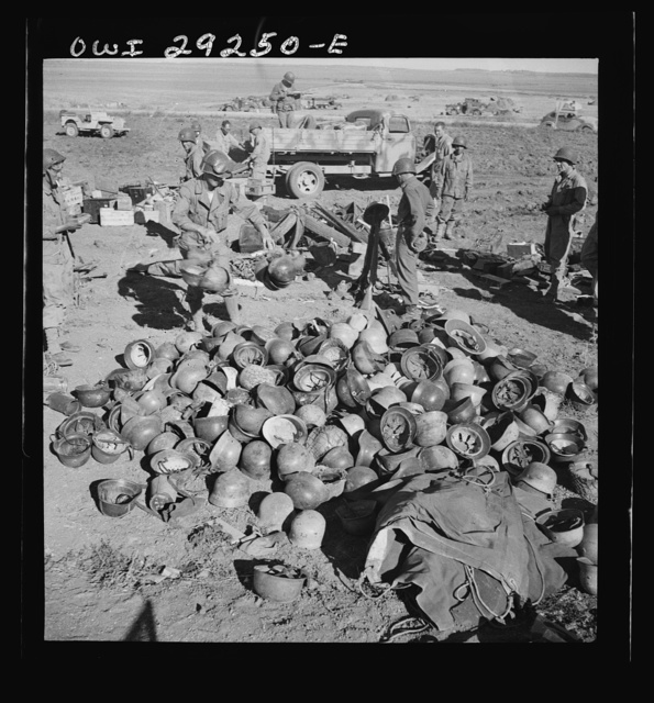 Pile of German helmets left by the Tenth and Fifteenth Panzer Divisions when their evacuation attempts from Porto Farina were frustrated