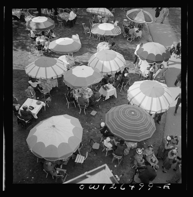 Pimlico racetrack, near Baltimore, Maryland. Outdoor diner sitting under beach umbrellas