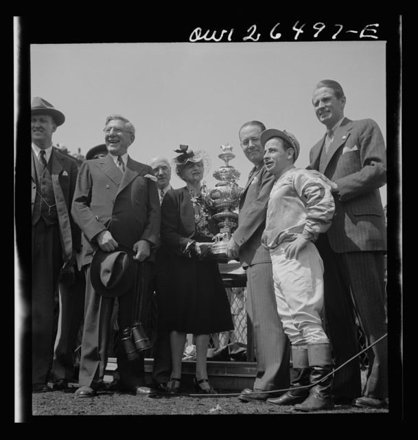 Pimlico racetrack, near Baltimore, Maryland. Owner and jockey of Count Fleet receiving Preakness Cup