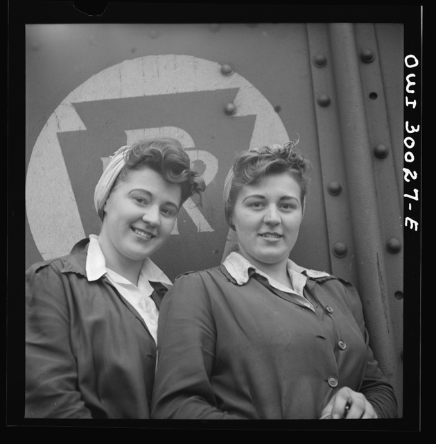 Pitcairn, Pennsylvania. Twins Amy and Mary Rose Lindich, twenty-one, employed at the Pennsylvania Railroad as car repairmen helpers, earning seventy-two cents per hour. They reside in Jeanette, Pennsylvania, and carpool with fellow workers