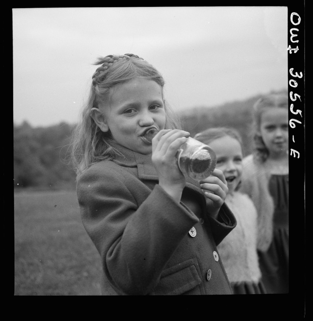 Pittsburgh, Pennsylvania. A child drinking Pepsi Cola before the service held on Memorial Day at the Lithuanian cemetery