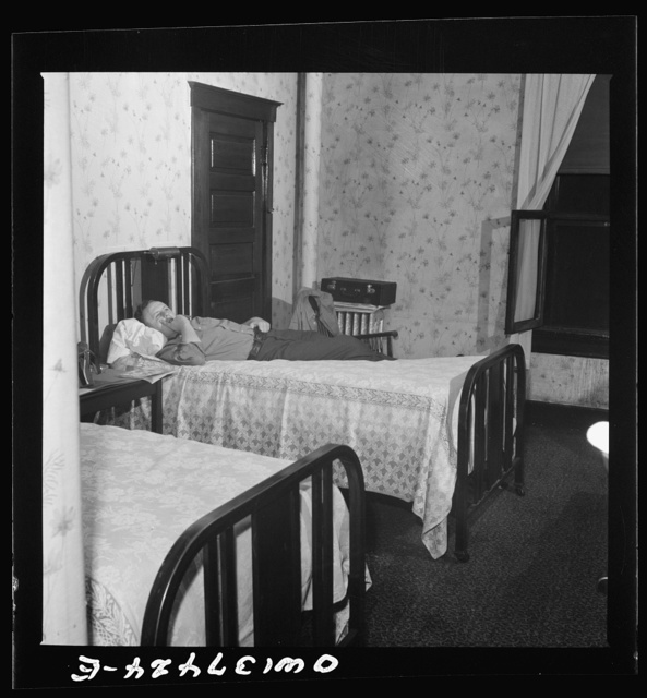 Pittsburgh, Pennsylvania. Hotel room where Clem Carson, a Greyhound driver, lives and which he shares with another bus driver. They each pay six dollars a week