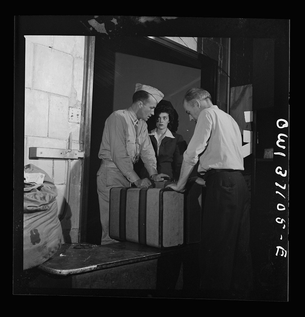 Pittsburgh, Pennsylvania. Passengers checking their bags at the Greyhound bus terminal