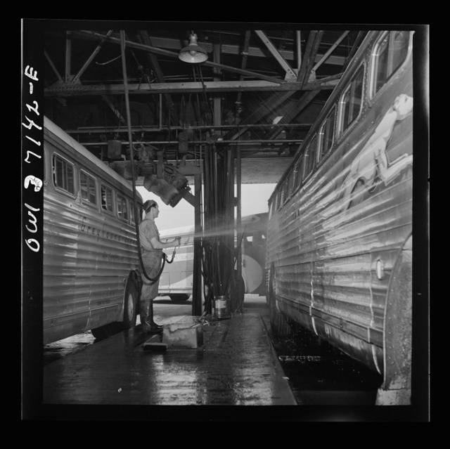 Pittsburgh, Pennsylvania. Washing a bus at the Greyhound garage