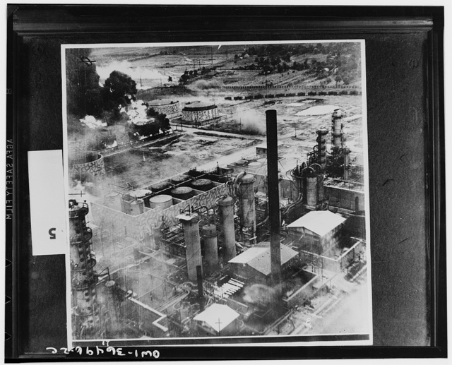 Ploesti, Romania. August 1, 1943. Oil storage tanks at the Columbia Aquila refinery burning after the raid of B-24 Liberator bombers of the United States Army Air Force. Some of the structures have been camouflaged