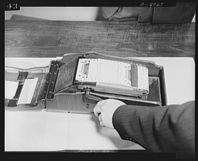 """Plywood autographic registers. New """"Victory"""" model autographic register made almost entirely of plywood contains only five ounces of critical metal. Even the moving parts inside are made of wood"""