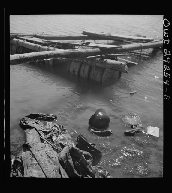 Porto Farina, Tunisia. A German raft, boot and helmet in water after American and British soldiers frustrated the evacuation attempt of German 10th and 15th panzer divisions