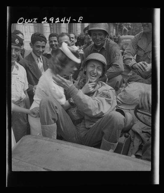 Porto Farina, Tunisia. Girl kissing a United States Army war correspondent