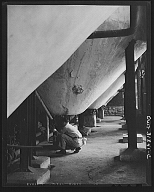 Proctor and Gamble Distributing Company, Cincinnati, Ohio. The bottom of some of the soap kettles in which fats are cooked. The soap kettles are three stories tall