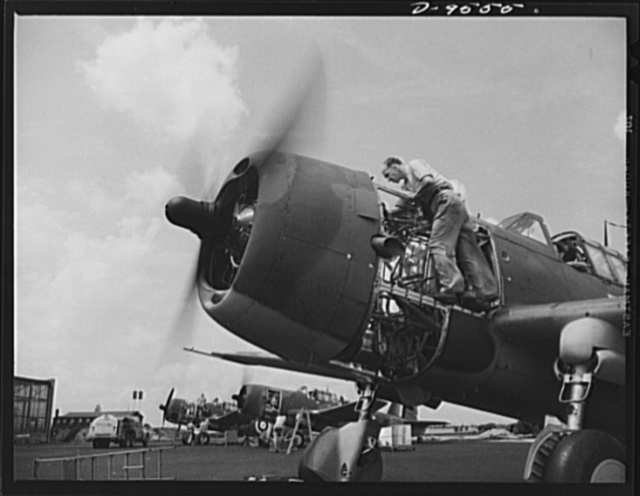 "Production. A-31 (""Vengeance"") dive bombers. Carburetor adjustment. A flight service mechanic is shown here making adjustments on the carburetor of a ""Vengeance"" dive bomber manufactured at Vultee's Nashville Division. The ""Vengeance"" (A-31) was originally designed for the French. It was later adopted by the RAF (Royal Air Force) and still later by the U.S. Army Air Forces. It is a single-engine, low-wing plane, carrying a crew of two men and having six machine guns of varying calibers"