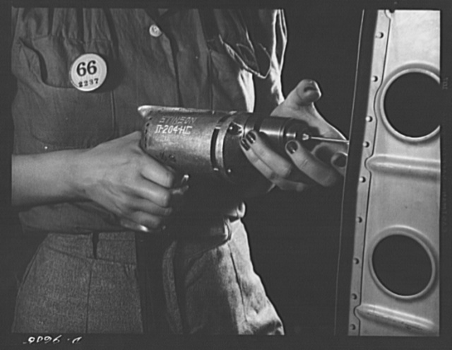 "Production. A-31 (""Vengeance"") dive bombers. Drilling a horizontal stabilizer. Here is a close-up view of a woman worker at the Nashville Division of Vultee Aircraft Inc., drilling rivet holes in the horizontal stabilizer for the Vultee ""Vengeance"" dive bomber. The ""Vengeance"" (A-31) was originally designed for the French. It was later adopted by the RAF (Royal Air Force) and still later by the U.S. Army Air Forces. It is a single-engine, low-wing plane, carrying a crew of two men and having six machine guns of varying calibers"