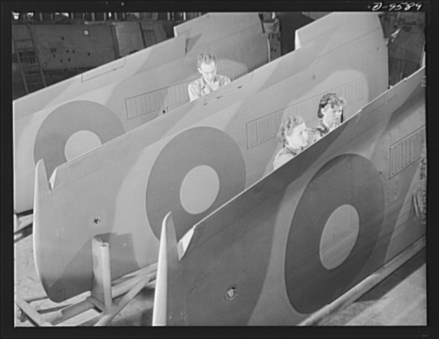 """Production. A-31 (""""Vengeance"""") dive bombers. Flap installation. These workers at Vultee's Nashville plant are making flap installations on a row of outer wings which will subsequently be installed on Vultee """"Vengeance"""" dive bombers. The """"Vengeance"""" (A-31) was originally designed for the French. It was later adopted by the RAF (Royal Air Force) and still later by the U.S. Army Air Forces. It is a single-engine, low-wing plane, carrying a crew of two men and having six machine guns of varying calibers"""