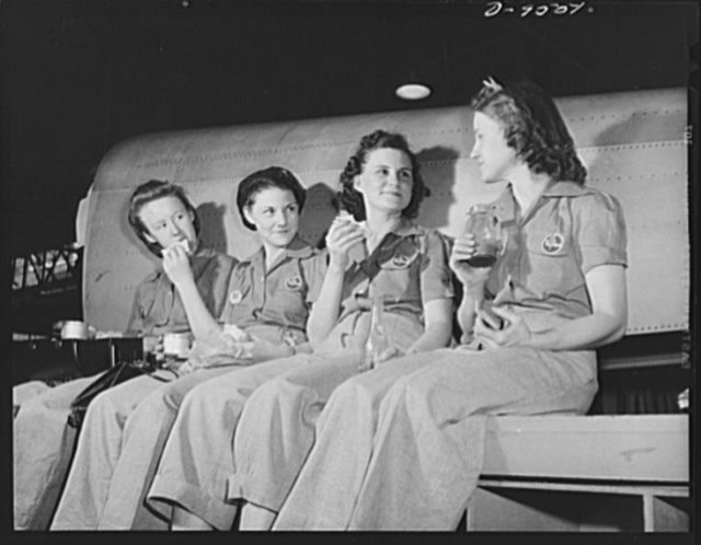 "Production. A-31 (""Vengeance"") dive bombers. Lunch time. Relaxing by their work--a fuselage section of a Vultee ""Vengeance"" dive bomber made at Vultee's Nashville Division--four women workers enjoy a well-earned lunch. The ""Vengeance"" (A-31) was originally designed for the French. It was later adopted by the RAF (Royal Air Force) and still later by the U.S. Army Air Forces. It is a single-engine, low-wing plane, carrying a crew of two men and having six machine guns of varying calibers"
