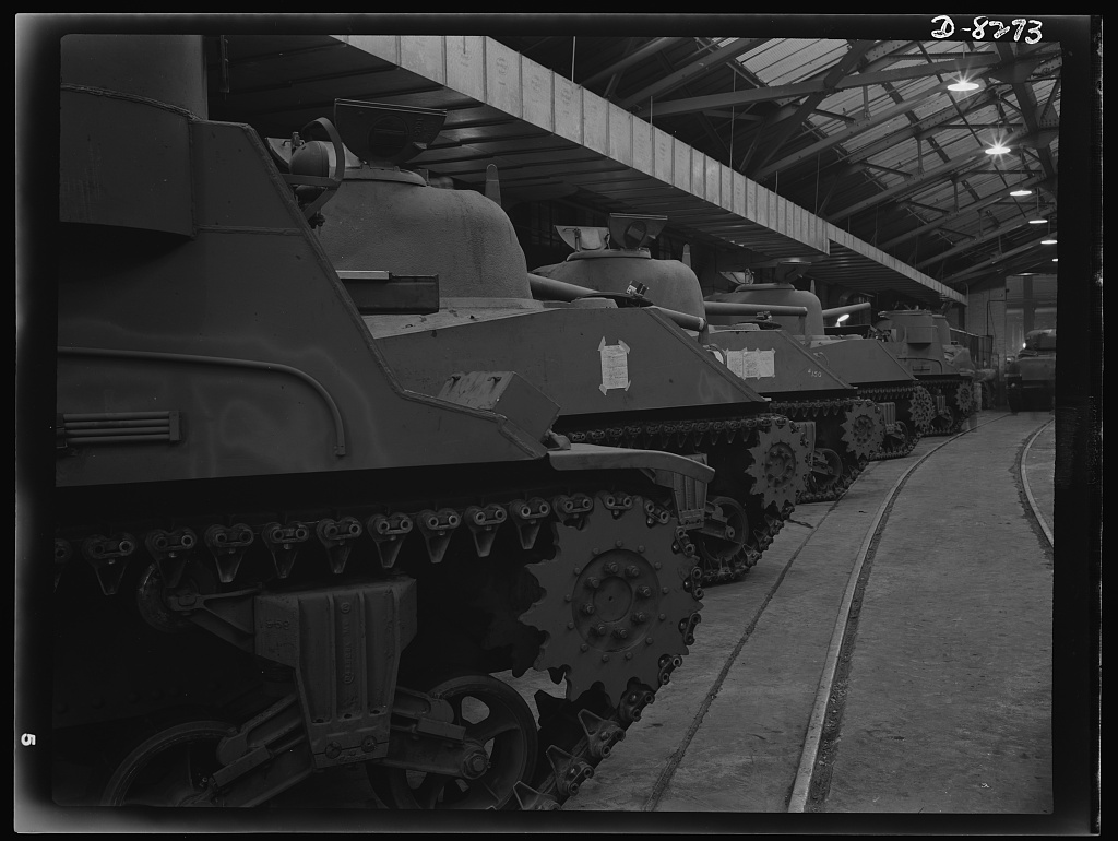 Production. M-4 tanks. M-4 tanks and M-7 mobile howitzer carriages roll off the production lines of the American Locomotive Company in Schenectady, New York. A portion of an M-7 shows in the right foreground, followed by three M-4's and another M-7