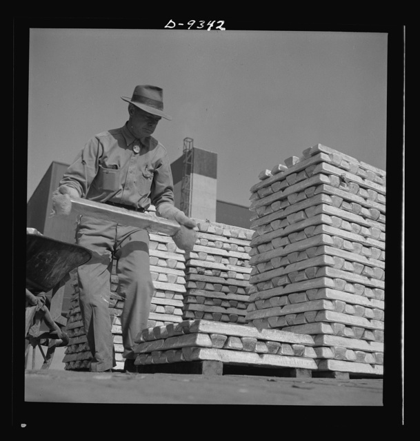 Production. Magnesium. Enormous asbestos mittens must be worn by men handling the thousands of hot magnesium ingots produced daily at Basic Magnesium's giant plant in the southern Nevada desert. A number of units of this plant are now in production. Full operation is scheduled for the summer of 1943