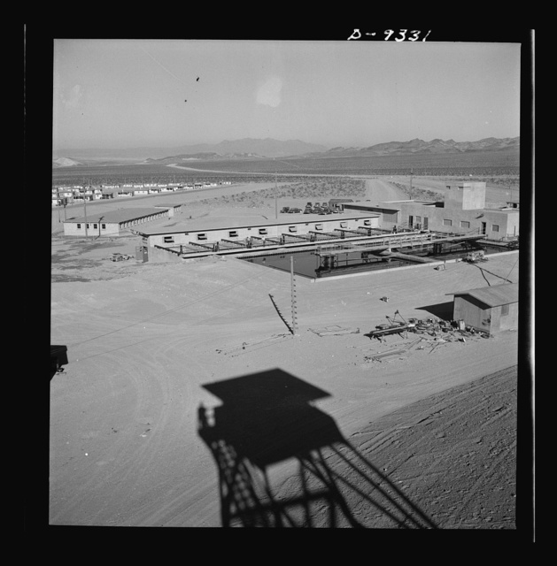 Production. Magnesium. The shadow of a watchtower at the huge Basic Magnesium plant in the southern Nevada desert points to a water treatment plant in which water piped for miles is conditioned for many uses in the plant and its employee housing development
