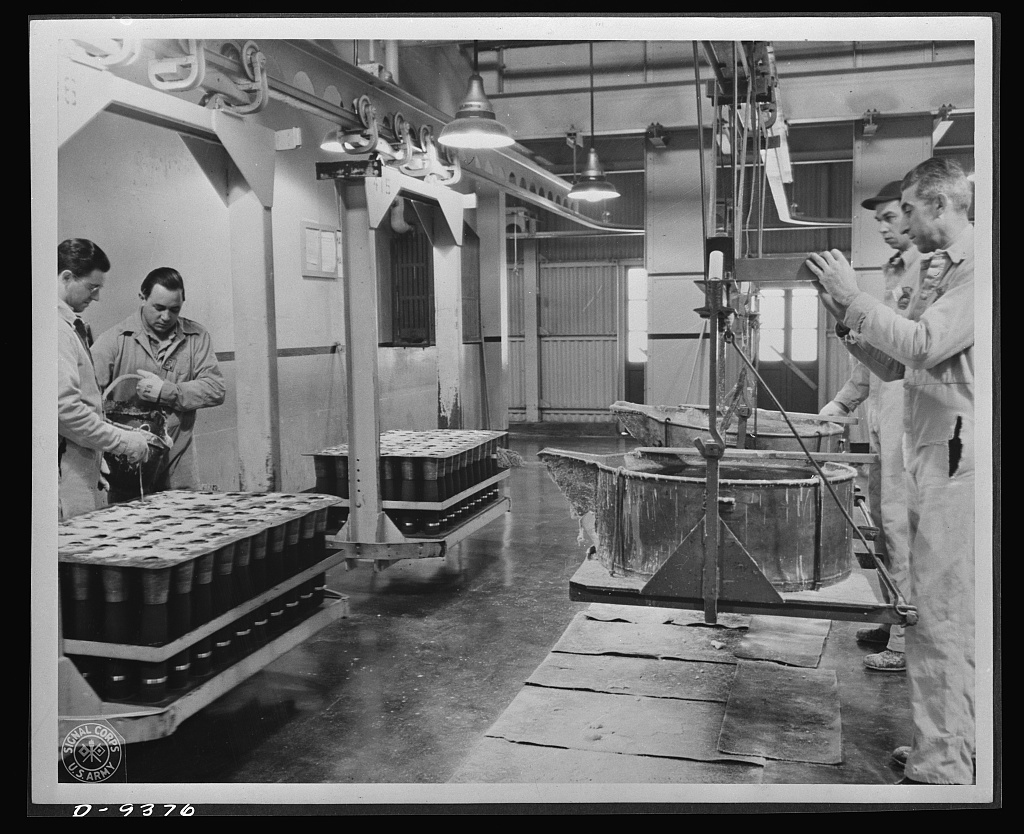 Production. Shell loading. Molten TNT is poured into 75 mm. shells at a large Midwest loading plant. Shells from 20 mm. to 155 mm. are loaded at this plant in addition to special shells required by the British. Ravenna ordnance plant