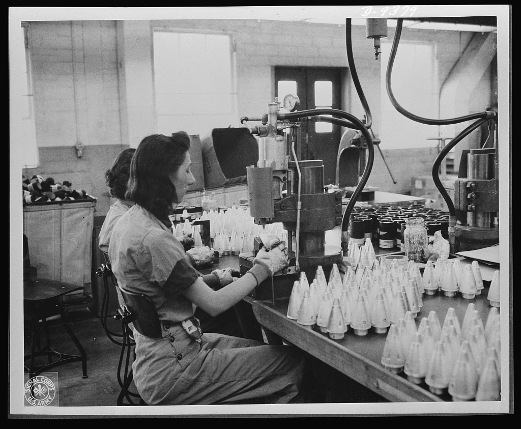 """Production. Shell loading. These girls are """"staking"""" fuses in the assembly of artillery shells in a large Midwest loading plant. In the manufacture and loading of percussion caps--an operation performed in a large division of the plant--ninety percent of the employees are women. Army officers say the women speed up production. Ravenna ordnance plant"""