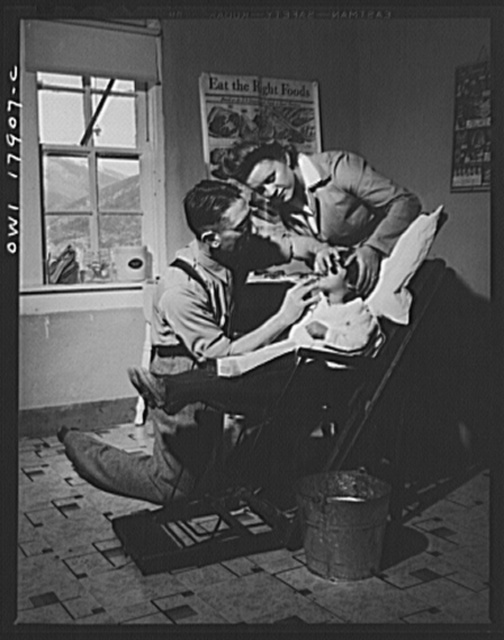 Questa, New Mexico. Dentist making an extraction in the clinic operated by the Taos County cooperative health association
