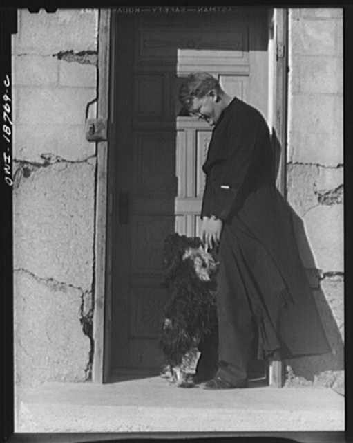 Questa, Taos County, New Mexico. Father Smith, the parish priest