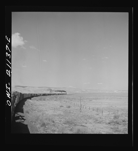 Quirk (vicinity), New Mexico. A train rounding a curve along the Atchison, Topeka and Santa Fe Railroad between Belen and Gallup, New Mexico