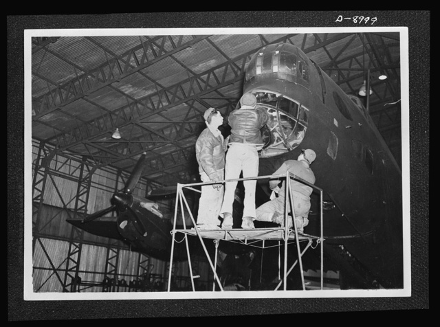 Reciprocal aid. An American crew at work on a British Halifax four-engined bomber evidence of the close cooperation between British and U.S. forces in Britain. U.S. ground technicians as well as fighter squadrons, are working with members of the Royal Air Force (RAF) and the Women's Auxiliary Air Force (WAAF) at many of the airfields which have been handed over to U.S. Army Air Forces under the British Reciprocal Aid Program