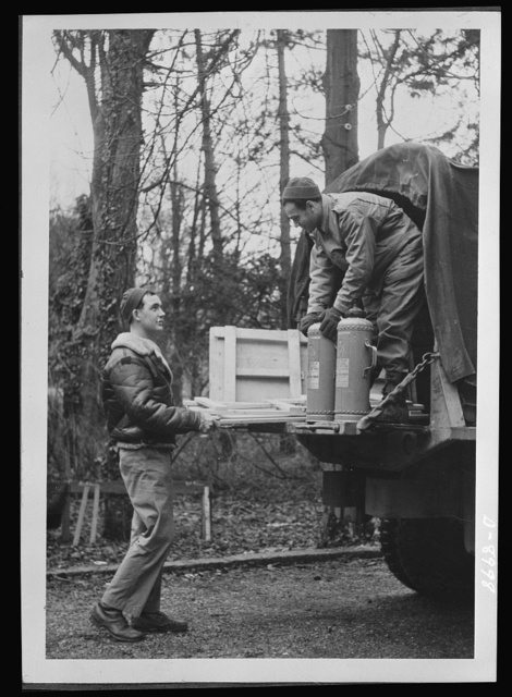 Reciprocal aid. Private Michael Fuller of New York City and Sergeant J.L. Schnider of Chicago unload British tables and fire extinguishers for use by the American air forces in Britain. American and British air forces work side by side in the European theatre, with Britain furnishing important supplies and equipment under the Reciprocal Aid Program