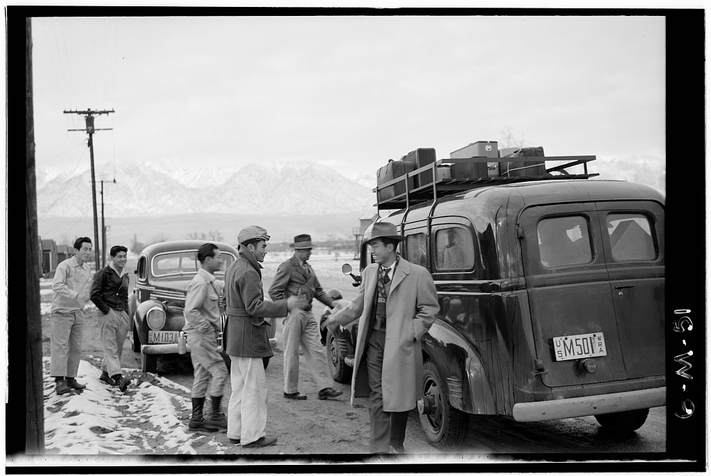 Relocation departure, Manzanar Relocation Center / photograph by Ansel Adams.