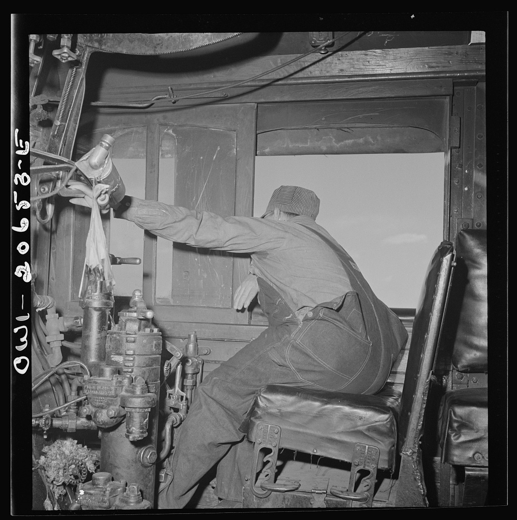 Ricardo, New Mexico. Engineer in his cab about to start the train along the Atchison, Topeka, and Santa Fe Railroad between Clovis and Vaughn, New Mexico