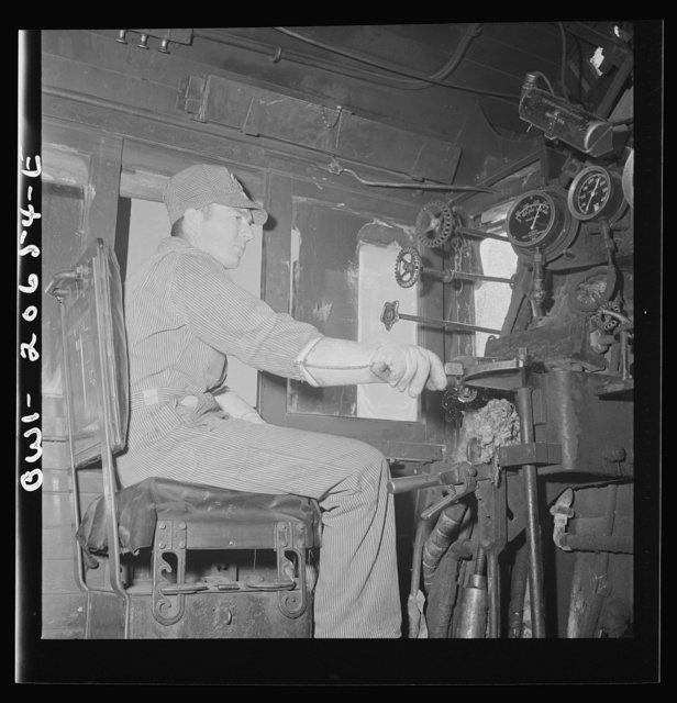 Ricardo, New Mexico. Fireman C.P. Fryer in his cab on the Atchison, Topeka, and Santa Fe Railroad, between Clovis and Vaughn, New Mexico