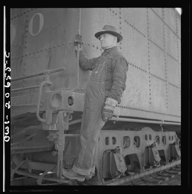Ricardo, New Mexico. Head brakeman Thomas H. Knight on the Atchison, Topeka, and Santa Fe Railroad between Clovis and Vaughn, New Mexico