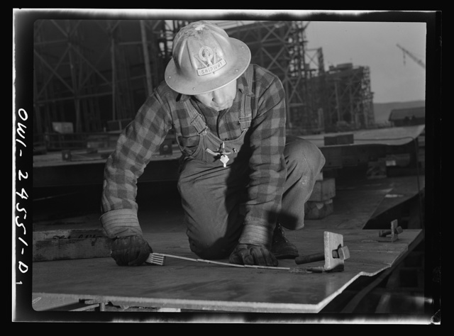Richmond, California. Permanente Metals Corporation, shipbuilding division, yard number two. V. De Martini has worked in the yard for ten months. He was born in Italy, and has been in the United States thirty-four years