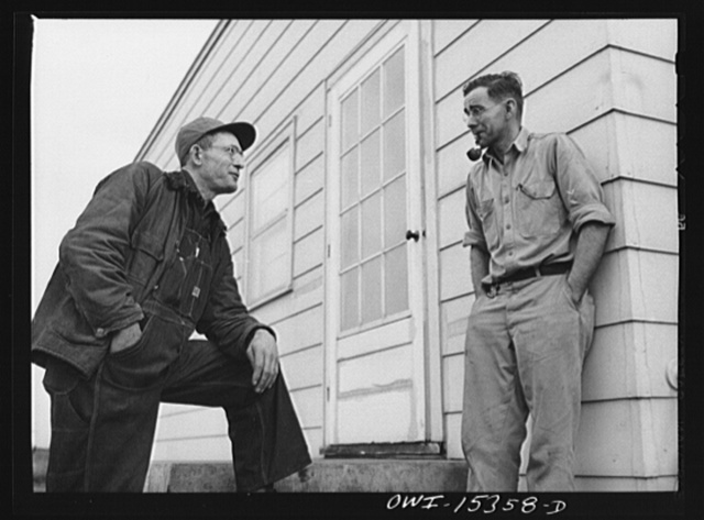 Rio Grande, Gallia County, Ohio. Mr. Younkers talking with his boss, Fred Bowers, poultry farmer. Mr. Younkers, his wife and three sons have come up from Kentucky