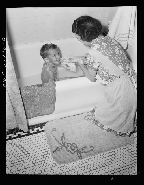 Rochester, New York. Earl Babcock's mother helping with his bath