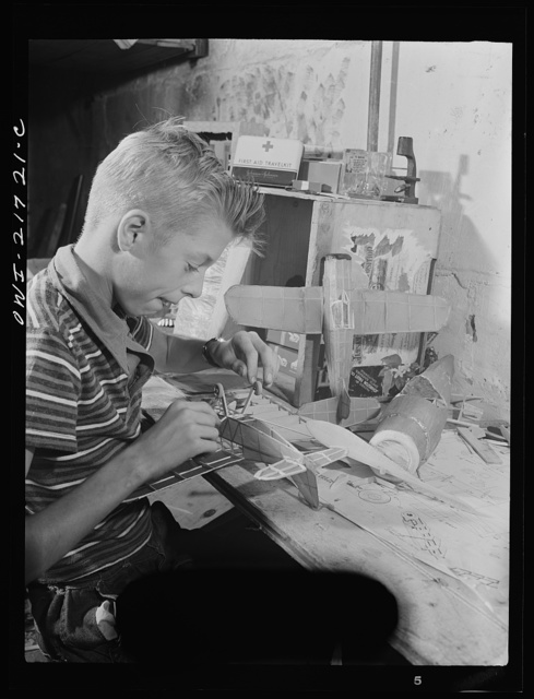 Rochester, New York. Howard Babcock hard at work on one of his model airplanes