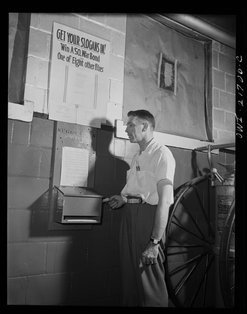 Rochester, New York. Mr. Babcock using the suggestion box at the plant to submit an idea for saving time