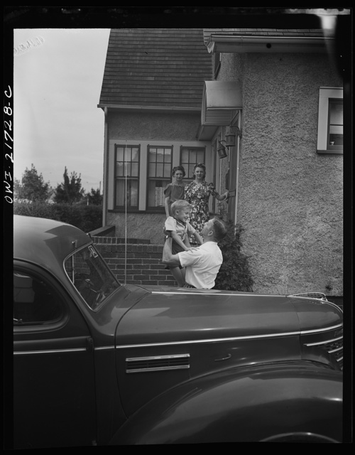 Rochester, New York. Mrs. Babcock, Shirley, and Earl greeting Mr. Babcock in front of the house