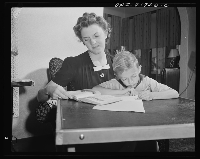 Rochester, New York. Shirley Babcock helping her brother Earl with his lessons