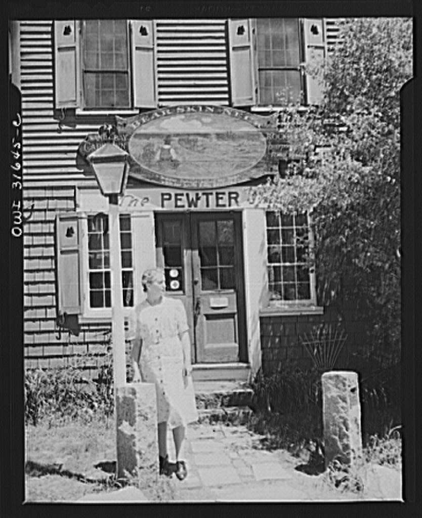 Rockport, Massachusetts. Mrs. Whitney in front of her home and the pewter shop