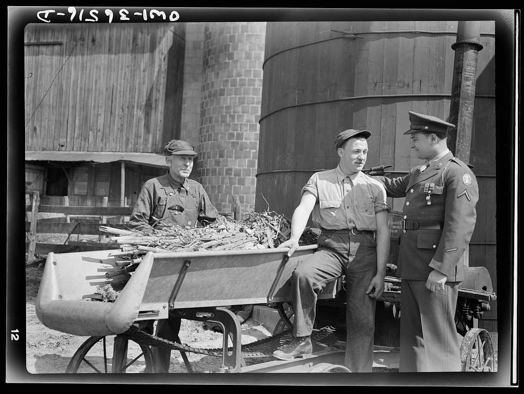 Rockville (vicinity), Maryland. Private Harvey Horton, visiting the N.C. Stiles dairy farm while on furlough from Fort Belvoir, Virginia, talking with Mr. Stiles and his nineteen-year-old son Robert