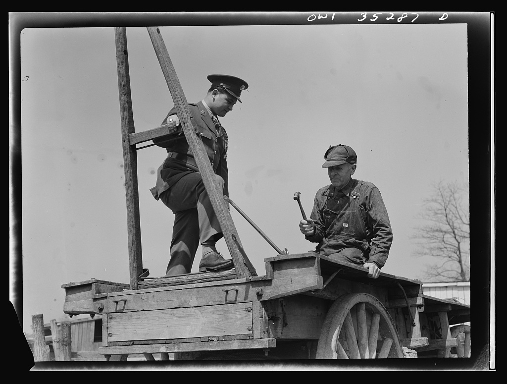 Rockville (vicinity), Maryland. Private Harvey Horton, visiting the N.C. Stiles dairy farm while on furlough from Fort Belvoir, Virginia, with Mr. Stiles