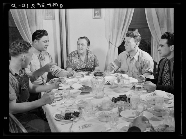 Rockville (vicinity), Maryland. Private Harvey Horton, visiting the N.C. Stiles dairy farm while on furlough from Fort Belvoir, Virginia, at lunch with the family