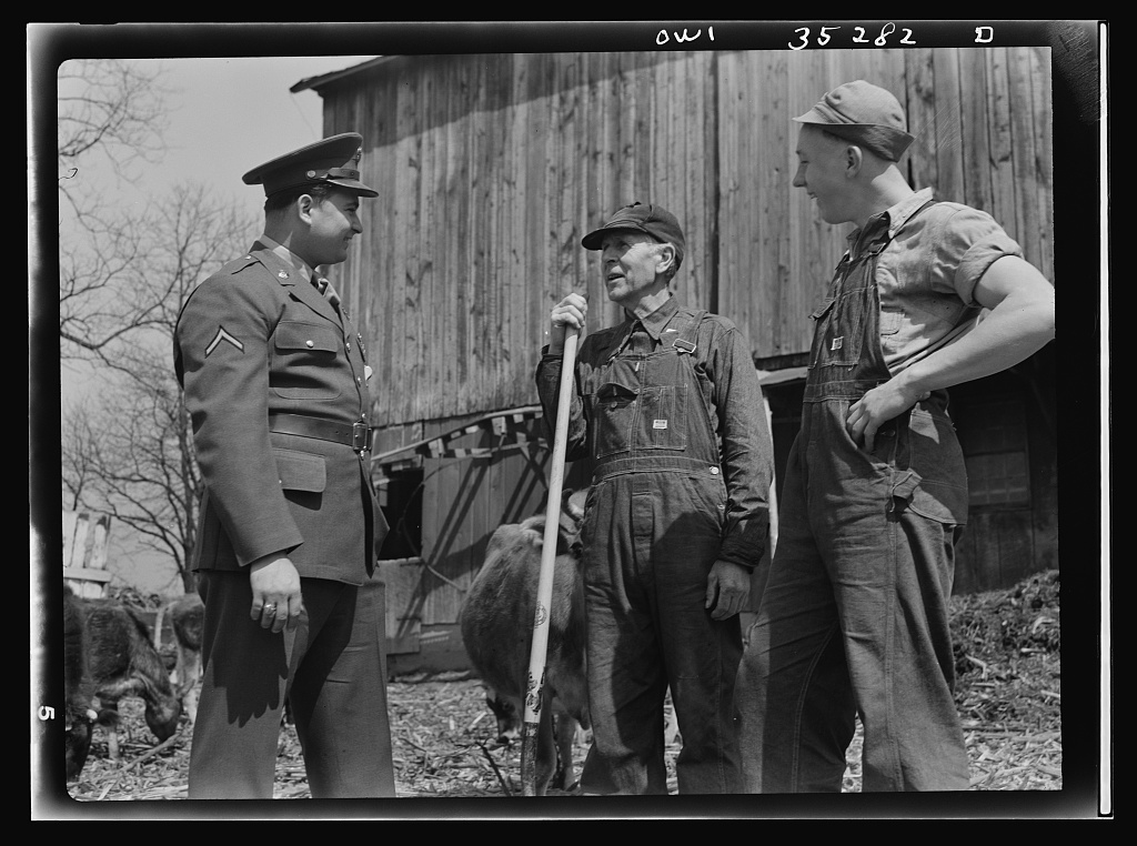 Rockville (vicinity), Maryland. Private Harvey Horton, visiting the N.C. Stiles dairy farm while on furlough from Fort Belvoir, Virginia, talking with Mr. Stiles and sixteen-year-old Charles Stiles