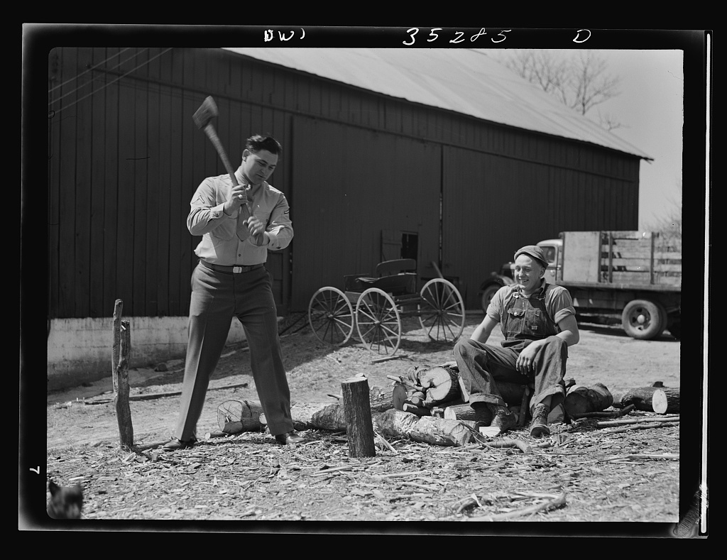 Rockville (vicinity), Maryland. Private Harvey Horton, visiting the N.C. Stiles dairy farm while on furlough from Fort Belvoir, Virginia, getting a little exercise before lunch