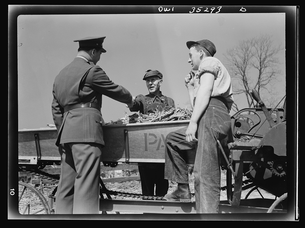 Rockville (vicinity), Maryland. Private Harvey Horton, visiting the N.C. Stiles dairy farm while on furlough from Fort Belvoir, Virginia, being greeted by Mr. N.C. Stiles and his nineteen-year-old son Robert