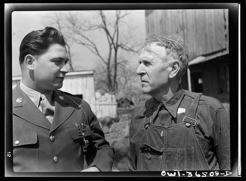 Rockville (vicinity), Maryland. Private Harvey Horton, visiting the N.C. Stiles dairy farm while on furlough from Fort Belvoir, Virginia, talking with Mr. Stiles