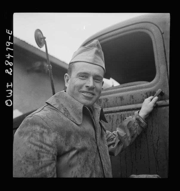Russian-born Master Sergeant Nicholas Chekmorath of Tacoma, Washington, chief inspector at the United States truck assembly plant. He has been in the American Army seventeen years--sixteen of them in the tank corps. Sergeant Chekmorath deals with Russian truck inspectors somewhere in Iran